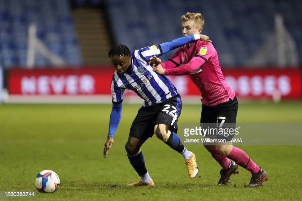 Moses Odubajo of Sheffield Wednesday and Louie Sibley of Derby County during the Sky Bet Championship match between Sheffield Wednesday and Derby...