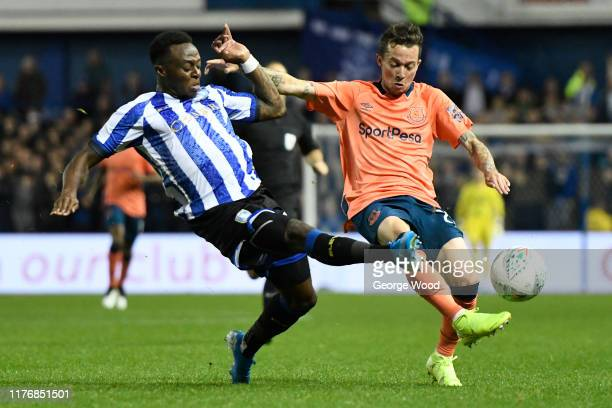 Moses Odubajo of Sheffield Wednesday tackles Bernard of Everton during the Carabao Cup Third Round match between Sheffield Wednesday and Everton FC...