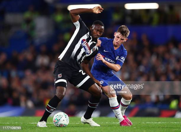 Moses Ogbu of Grimsby Town battles for possession with Billy Gilmour of Chelsea during the Carabao Cup Third Round match between Chelsea FC and...