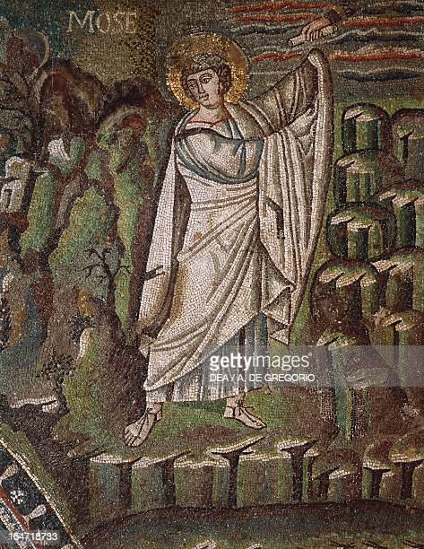 Moses on Mount Sinai receiving the Scroll of the Law mosaic right of the lunette northern wall of the presbytery Basilica of San Vitale Ravenna...