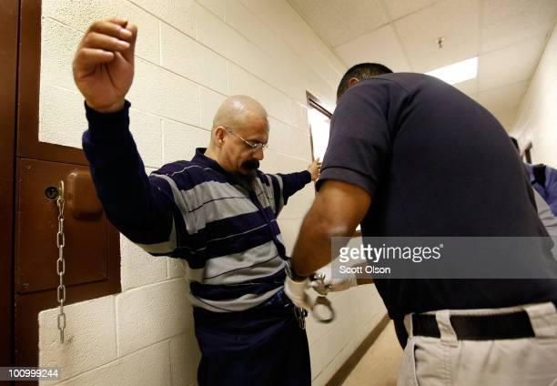 Moses PradoCalpillo is shackled before being taken to a deportation flight chartered by US Immigration and Customs Enforcement May 25 2010 in...