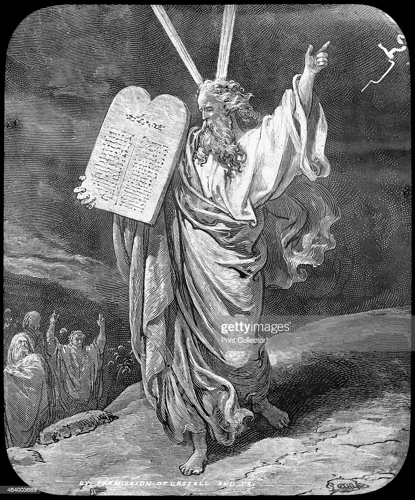 Moses receives the law, late 19th or early 20th century. Moses receiving the Ten Commandments from God on Mount Sinai, as described in Exodus. Lantern slide.