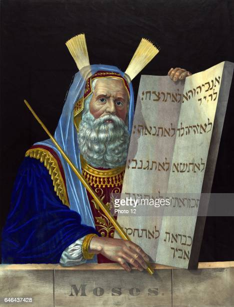 Moses religious leader and principal prophet of Israelite Moses is holding the tablets inscribed with the Ten Commandments given him by God on Mount...