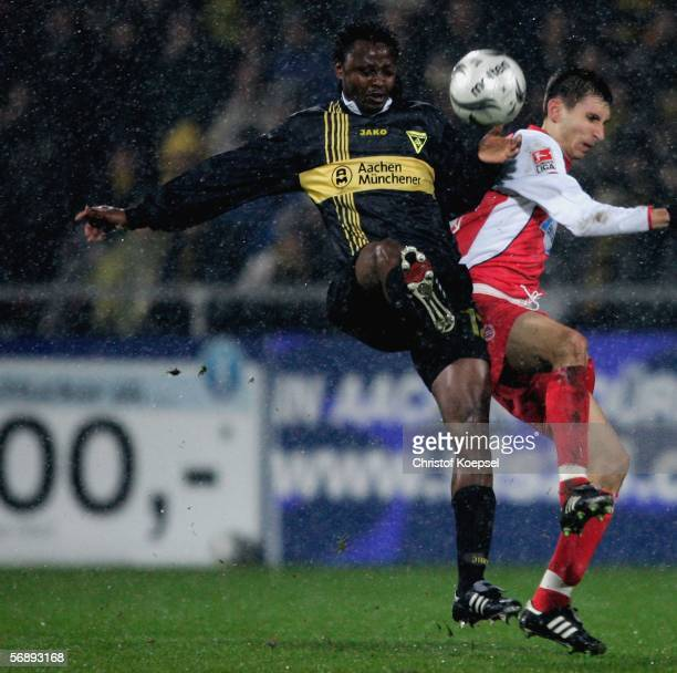 Moses Sichone of Aachen tackles Sergiu Radu of Cottbus during the Second Bundesliga match between Alemannia Aachen and Energie Cottbus at the Tivoli...