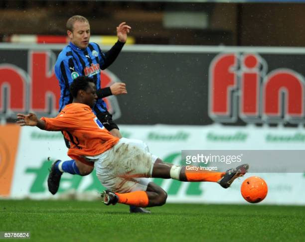 Moses Sichone of Aalen tackles Frank Loening of Paderborn during the 3 Bundesliga match between SC Paderborn and VFR Aalen at the Paragon Arena on...