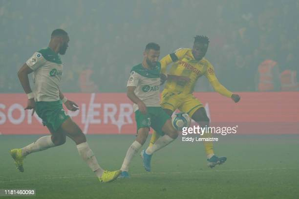 Moses SIMON of Nantes and Franck HONORAT of Saint Etienne during the Ligue 1 match between Nantes and Saint Etienne at Stade de la Beaujoire on...