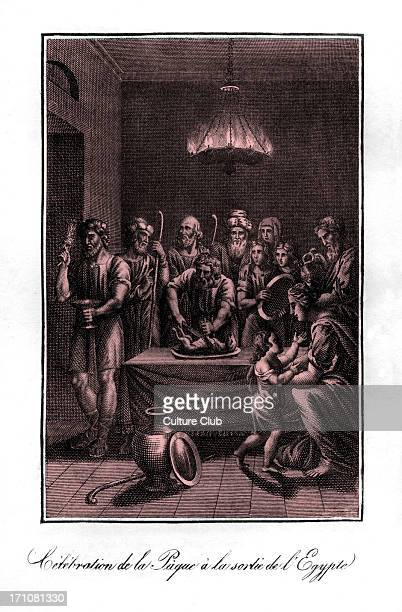Moses slaughters a lamb for Passover before leeaving Egypt as an elder prepares to paint the doorframe with its blood using a bunch of hyssop in...