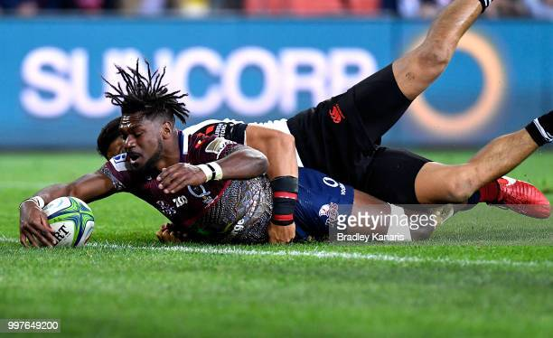 Moses Sorovi of the Reds scores a try during the round 19 Super Rugby match between the Reds and the Sunwolves at Suncorp Stadium on July 13 2018 in...