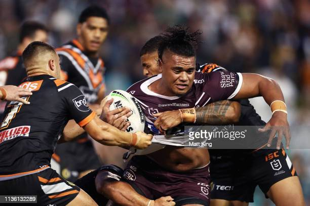 Moses Suli of the Sea Eagles is tackled during the round 1 NRL match between the Wests Tigers and the Manly Warringah Sea Eagles at Leichhardt Oval...