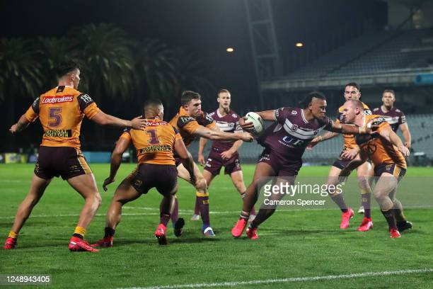 Moses Suli of the Sea Eagles is tackled during the round five NRL match between the Manly Sea Eagles and the Brisbane Broncos at Central Coast...