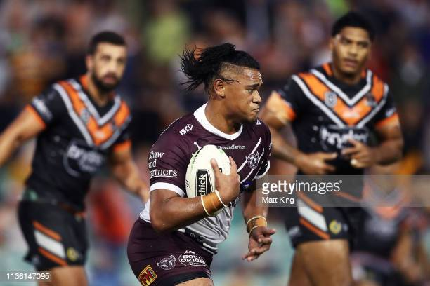 Moses Suli of the Sea Eagles runs with the ball during the round 1 NRL match between the Wests Tigers and the Manly Warringah Sea Eagles at...