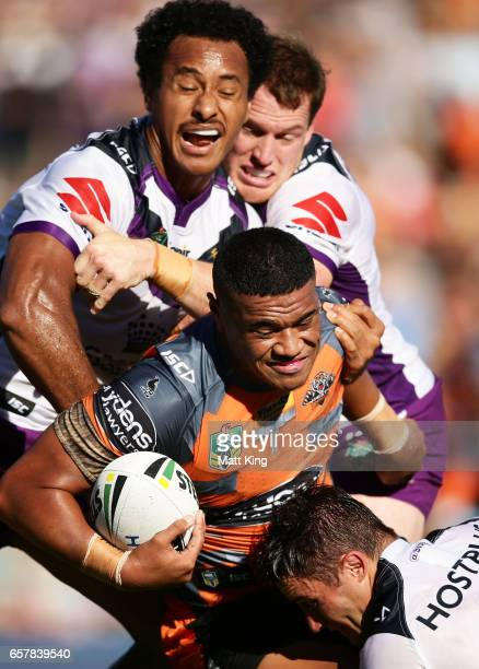Moses Suli of the Tigers is tackled during the round four NRL match between the Wests Tigers and the Melbourne Storm at Leichhardt Oval on March 26...