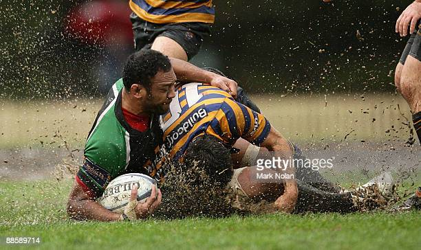 Mosese Makasini of Penrith is tackled during the round 12 Shute Shield match between Sydney University and Penrith at University Oval on June 20,...