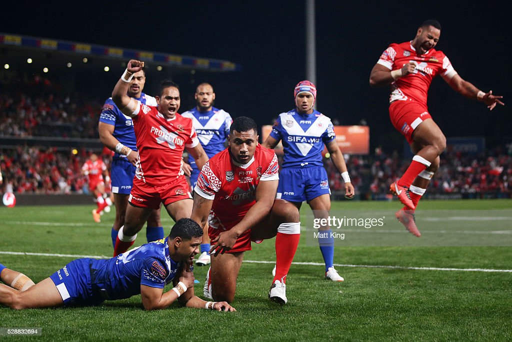 Mosese Pangai of Tonga celebrates with team mates after scoring a try during the International Rugby League Test match between Tonga and Samoa at Pirtek Stadium on May 7, 2016 in Sydney, Australia.