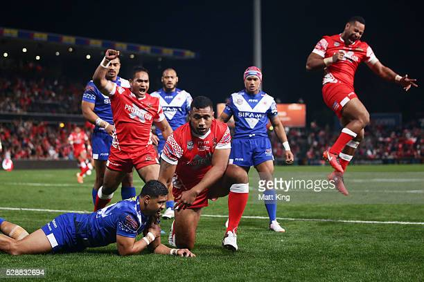 Mosese Pangai of Tonga celebrates with team mates after scoring a try during the International Rugby League Test match between Tonga and Samoa at...