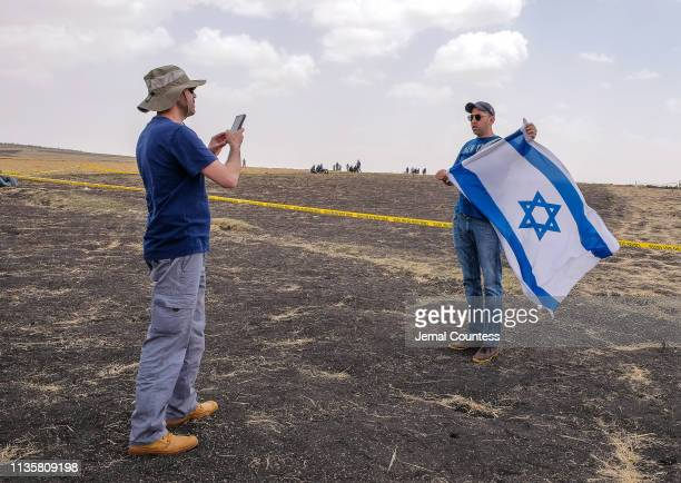 Moshe Biton of Israel poses for a photo in front of the site of the Ethiopian Airlines Flight ET302 crash on March 14 2019 in Ejere Ethiopia Moshe...