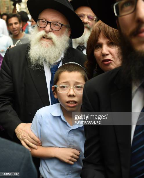 Moshe Holtzberg son of slain US Rabbi Gavriel Holtzberg who was killed along with his wife in the November 26 2008 attacks reacts as he arrives with...