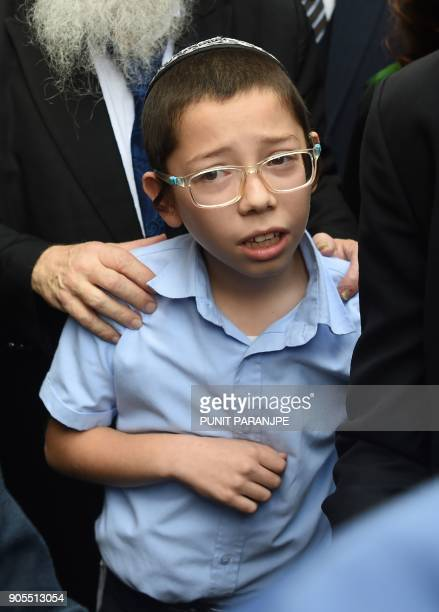 Moshe Holtzberg son of slain US Rabbi Gavriel Holtzberg who was killed along with his wife in the November 26 2008 attacks reacts as he arrives at...