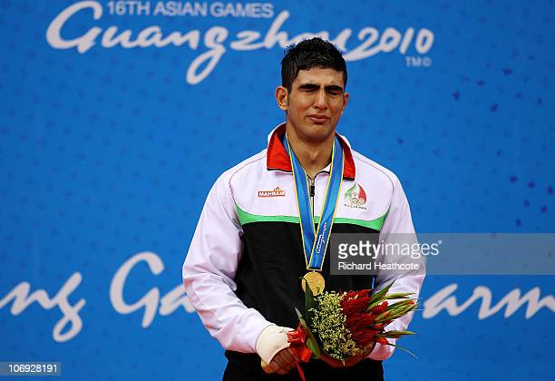 Moshen Mohammadseifi of Iran celebrates winning the Gold medal in in the Men's 60kg Sanshou during day five of the 16th Asian Games Guangzhou 2010 at...