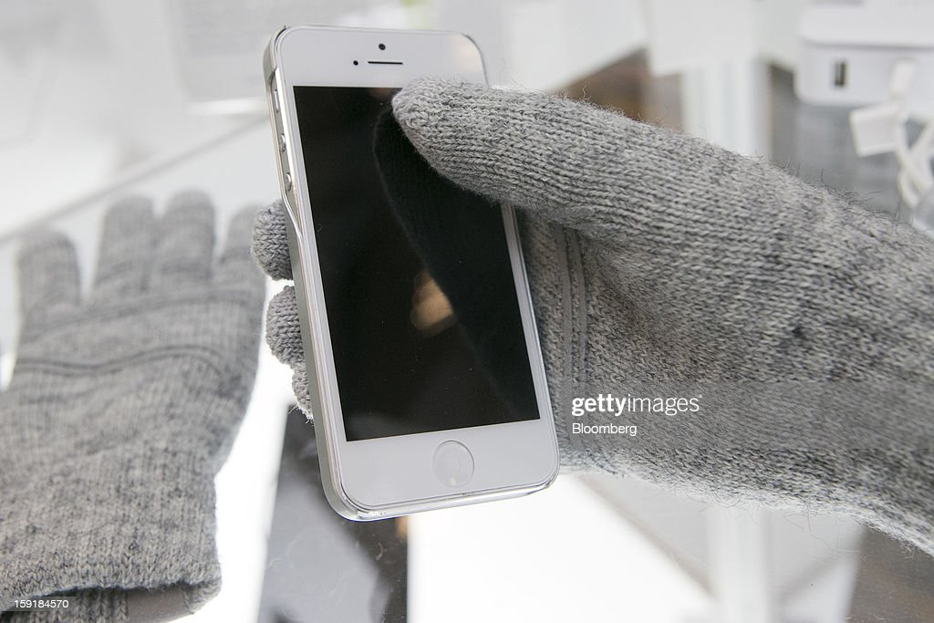 Moshi 'Digits' touch screen gloves are displayed during the 2013 Consumer Electronics Show in Las Vegas, Nevada, U.S., on Wednesday, Jan. 9, 2013. The 2013 CES trade show, which runs until Jan. 11, is the world's largest annual innovation event that offers an array of entrepreneur focused exhibits, events and conference sessions for technology entrepreneurs. Photographer: Andrew Harrer/Bloomberg via Getty Images