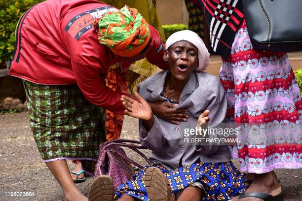 A Moshi resident in Kilimanjaro region north Tanzania is consoled at Mawenzi hospital on February 2 after the death of her granddaughter who was...