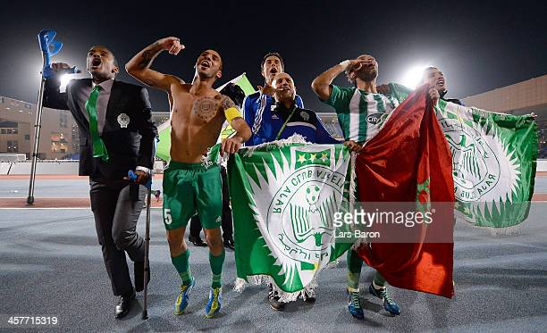 Moshine Moutaouali of Casablanca celebrates with team mates after winning the FIFA Club World Cup Semi Final match between Raja Casablanca and...