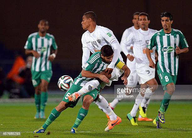 Moshine Moutaouali of Casablanca is challenged by Lucas of Mineiro during the FIFA Club World Cup Semi Final match between Raja Casablanca and...