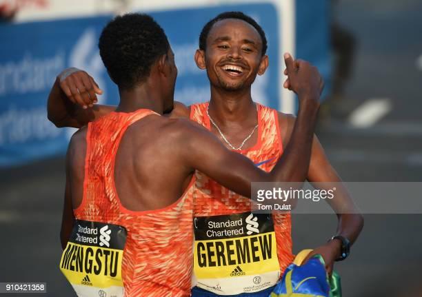 Mosinet Geremew Bayih of Etiopia celebrates winning the Standard Chartered Dubai Marathon on January 26 2018 in Dubai United Arab Emirates