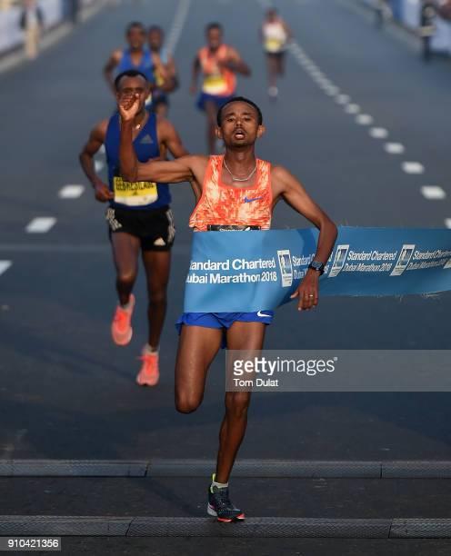 Mosinet Geremew Bayih of Etiopia crosses the finish line to win the Standard Chartered Dubai Marathon on January 26 2018 in Dubai United Arab Emirates