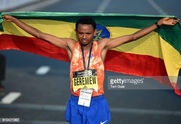 Mosinet Geremew Bayih of Etiopia poses for photographs after winning the Standard Chartered Dubai Marathon on January 26 2018 in Dubai United Arab...