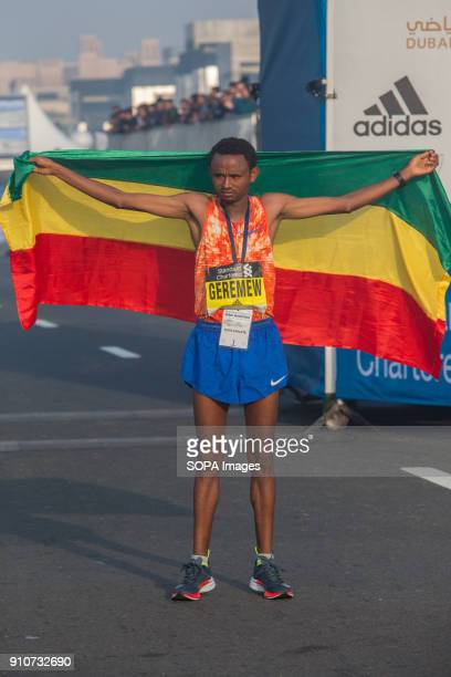Mosinet Geremew of Ethiopia celebrates his win the Standard Chartered Dubai Marathon 2018 in a new course record time of 20400