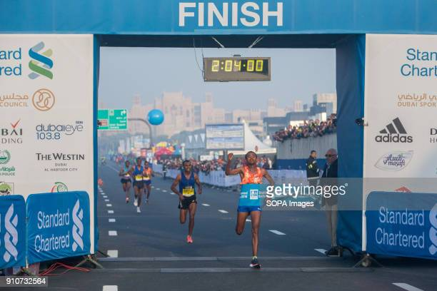 Mosinet Geremew of Ethiopia crosses the line to win the Standard Chartered Dubai Marathon 2018 in a new course record time of 20400