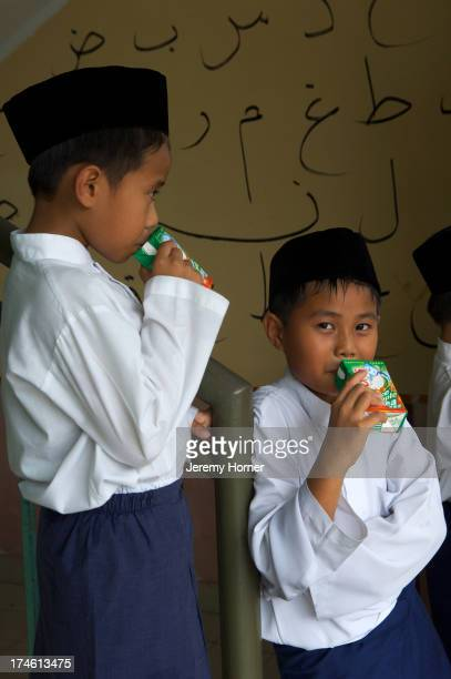 Moslem boys attend prayer classes each friday at the Sultan Omar Ali Saifuddin Mosque