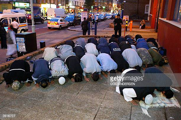 Moslem devotees of the radical Islamic group alMuhajiroun pray on the pavement outside 788 Tottenham High road in north London 11 September 2003 The...