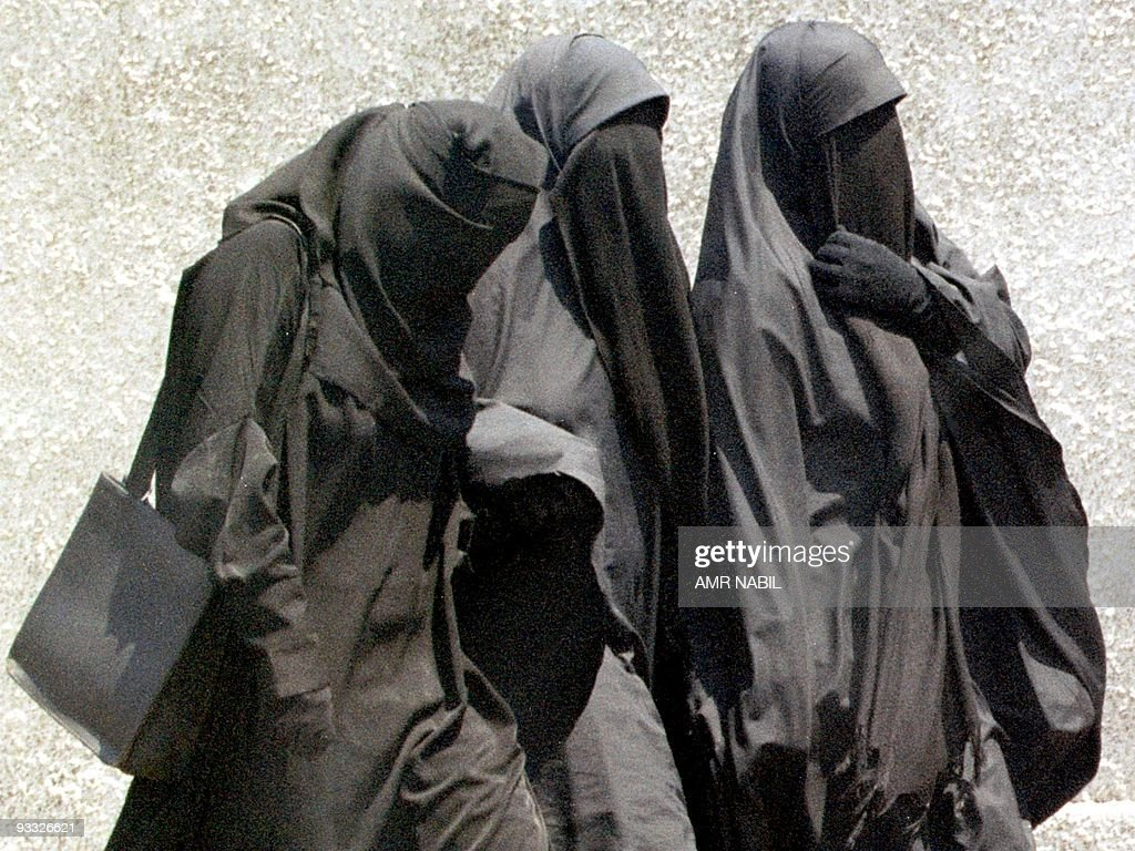 Moslem girls in Egypt wearing the niqab, or full face veil, walk to Friday prayers at a mosque in Cairo, 23 July 1999. A top Egyptian court has banned schoolgirls from wearing the niqab, ending a five-year legal battle between Islamic fundamentalist lawyers and the education ministry.