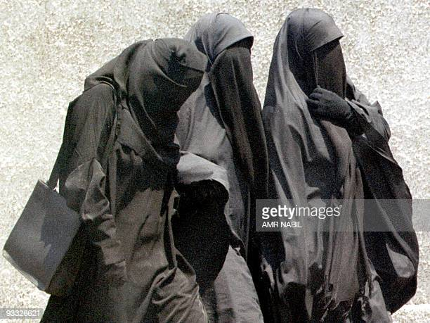 Moslem girls in Egypt wearing the niqab or full face veil walk to Friday prayers at a mosque in Cairo 23 July 1999 A top Egyptian court has banned...
