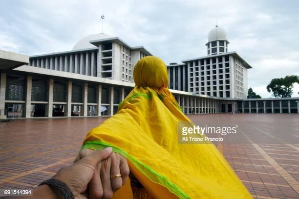 Moslem married couple in Istiqlal Mosque, Ramadan,  Jakarta
