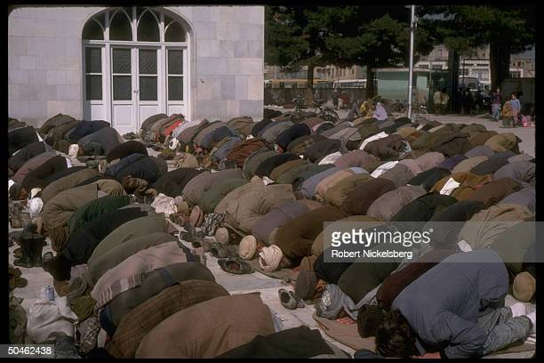 Moslem men bowing in observance during Fri prayers at main mosque in Kabul Afghanistan