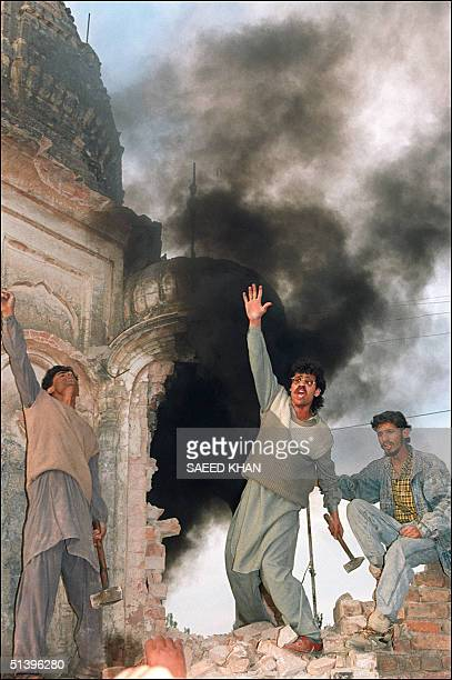 Moslem protesters shout antiindian slogans after setting a Hindu temple on fire and demolishing part of the stone work 07 December 1992 At least 11...