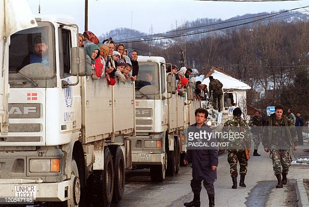 Moslem refugees ride United Nations vehicles 30 March 1993 in a 19truck convoy as they flee the Serbbesieged Bosnian enclave of Srebrenica for Tuzla...