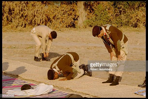 Moslem soldiers at prayer during Zarb-e-Momin exercise, maneuvers to simulate India-Pakistan battle.