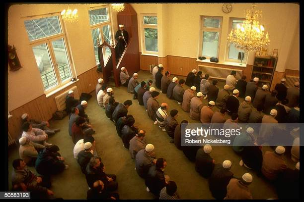 Moslem Turks attending service at mosque serving 130,000 strong Turkish community residing in W. Berlin, Germany.