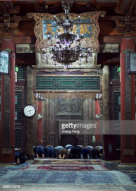 XI'AN SHAANXI CHINA Moslems are making worship in the main hall of the Xi'an Great Mosque The hall can hold 1000 believers to do their religious...
