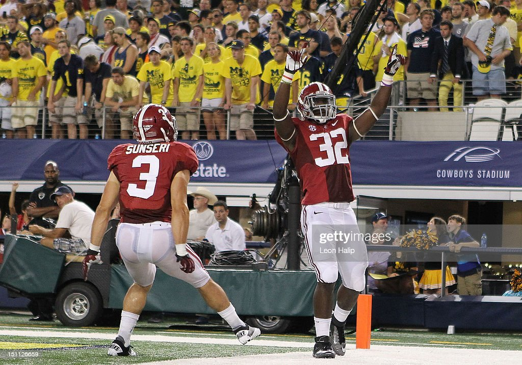 C. J. Mosley #32 of Alabama celebrates after scoring on a 16 yard interception pass from Denard Robinson #16 of Michigan during the second quarter of the game at Cowboys Stadium on September 1, 2012 in Arlington, Texas.
