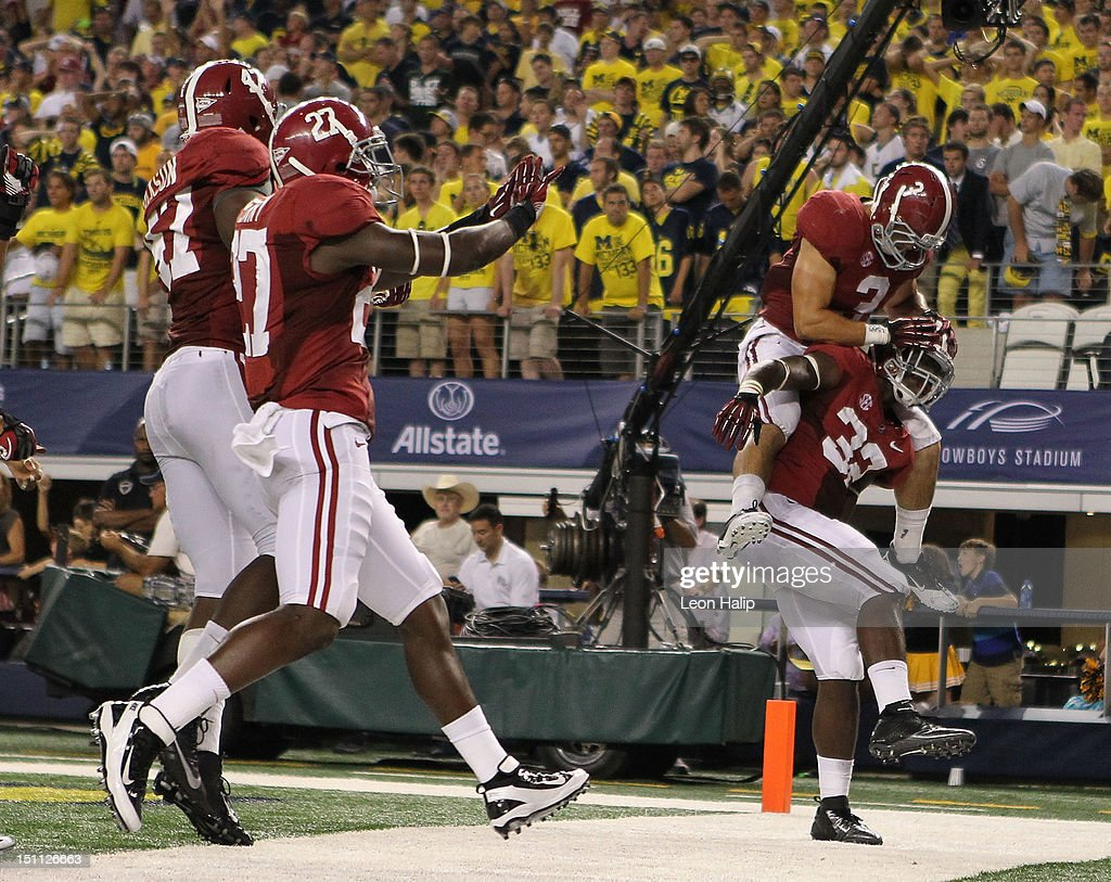 C. J. Mosley #32 of Alabama celebrates with teammate Vinnie Sunseri #3 after scoring on a 16 yard interception pass from Denard Robinson #16 of Michigan during the second quarter of the game at Cowboys Stadium on September 1, 2012 in Arlington, Texas.