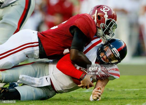 J Mosley of the Alabama Crimson Tide tackles Bo Wallace of the Mississippi Rebels at BryantDenny Stadium on September 28 2013 in Tuscaloosa Alabama