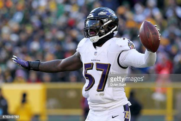 J Mosley of the Baltimore Ravens celebrates after recovering a fumble in the fourth quarter against the Green Bay Packers at Lambeau Field on...