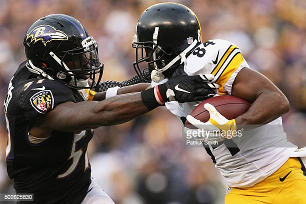 J Mosley of the Baltimore Ravens defends Antonio Brown of the Pittsburgh Steelers at MT Bank Stadium on December 27 2015 in Baltimore Maryland