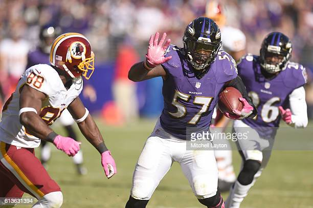 J Mosley of the Baltimore Ravens runs back an intercepted pass in the fourth quarter during a football game against the Washington Redskins at MT...