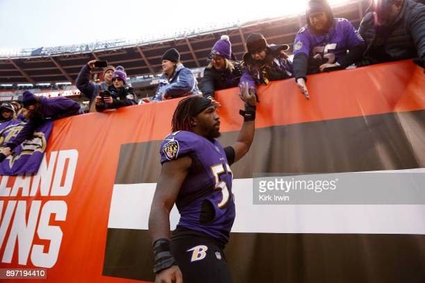 J Mosley of the Baltimore Ravens shakes hands with fans after the game against the Cleveland Browns at FirstEnergy Stadium on December 17 2017 in...